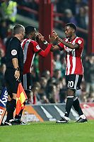 Josh Clarke of Brentford leaves the pitch for Florian Jozefzoon of Brentford during the Sky Bet Championship match between Brentford and Derby County at Griffin Park, London, England on 26 September 2017. Photo by Carlton Myrie / PRiME Media Images.