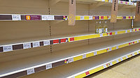 Pictured: Empty shelves in the white wine section, leaving available only the most expensive at the top shelf in the Sainsbury's super market, in Swansea, Wales, UK. <br /> Re: Covid-19 Coronavirus pandemic, UK.