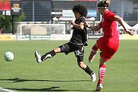 Eriko Arakawa (30) kicks the ball against Rebecca Moros (right).  Washington Freedom defeated FC Gold Pride 4-3 at Buck Shaw Stadium in Santa Clara, California on April 26, 2009.