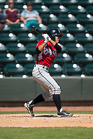 Eric Garcia (12) of the Carolina Mudcats follows through on his swing against the Winston-Salem Dash at BB&T Ballpark on April 22, 2015 in Winston-Salem, North Carolina.  The Dash defeated the Mudcats 4-2..  (Brian Westerholt/Four Seam Images)