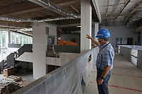 David Johnson, executive director of the Fayetteville Public Library, describes an area of the children's section Thursday, July 30, 2020, as he leads a tour of the the new expansion area of the library still under construction. The new addition of 82,500-square-feet will nearly double the size of the 88,000-square-foot main library. Check out nwaonline.com/200802Daily/ and nwadg.com/photos for a photo gallery.<br /> (NWA Democrat-Gazette/David Gottschalk)