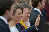 BOGOTÁ -COLOMBIA. 07-08-2014. Juan Manuel Santos, presidente reelecto de Colombia, saluda después de tomar posesión para su nuevo período constitucional como presidente 2014 - 2018 en las afueras del Capitolio Nacional en la ciudad de Bogotá./ Juan Manuel Santos, reelected president of Colombia, greets after he took office to his new constitutional term as president 2014 - 18 outseide of National Capitol in Bogota city. Photo: VizzorImage/ Gabriel Aponte / Staff
