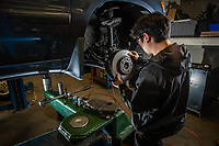 Automotive Technology student Justin Yi works on brake assemblies during instructor Randal Smith's brake systems (ADT A150) course in UAA's Automotive and Diesel Technology Building.