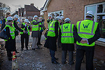 © Joel Goodman - 07973 332324 .  04/02/2014 . Manchester , UK . Media photograph and video as Ed Balls and Mike Kane examine pointing in the brickwork . Ed Balls , MP for Morley and Outwood and Shadow Chancellor of the Exchequer the Labour Party , joins Labour candidate Mike Kane on the campaign trail ahead of the Wythenshawe and Sale East by-election , following the death of MP Paul Goggins . They visit apprentices at the Leybrook Road building site in Wythenshawe where apprentice builders work on bungalows built for affordable rent . Photo credit : Joel Goodman