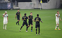 LOS ANGELES, CA - SEPTEMBER 13: Danny Musovski #16 of LAFC scores his goal and celebrates with team mate Eddie Segura #4 during a game between Portland Timbers and Los Angeles FC at Banc of California stadium on September 13, 2020 in Los Angeles, California.