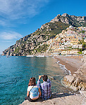 A couple capture the breathtaking view of Positano on the Amalfi Coast in Italy.
