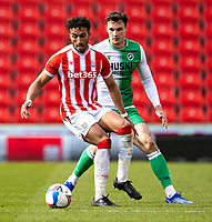 5th April 2021; Bet365 Stadium, Stoke, Staffordshire, England; English Football League Championship Football, Stoke City versus Millwall; Jacob Brown of Stoke City holds off Jake Cooper of Millwall