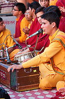 India, Rishikesh.  Monk Chanting Evening Prayers (Aarti) at Parmarth Niketan Ashram.