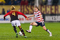 Heather O'Reilly (9) of the United States (USA) is defended by Babett Peter (4) of Germany (GER). The United States (USA) and Germany (GER) played to a 2-2 tie during an international friendly at Rentschler Field in East Hartford, CT, on October 23, 2012.