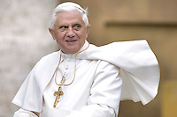 Pope Benedict XVI gestures while addressing pilgrims and faithful gathered in St. Peter's Square for his weekly general audience at the Vatican Wednesday, Nov. 22, 2006... .