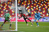 17th October 2020; Brentford Community Stadium, London, England; English Football League Championship Football, Brentford FC versus Coventry City; Ivan Ivan Toney of Brentford heads the ball to score his sides 2nd goal in the 54th minute to make it 2-0
