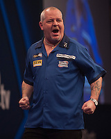 01.01.2014.  London, England.  William Hill World Darts Championship.  Quarter Final Round.  Robert Thornton (9) [SCO] celebrates a finish during his game with Michael van Gerwen (1) [NED]