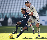 Calcio, Serie A: Juventus - Bologna, Turin, Allianz Stadium, January 24, 2021.<br /> Juventus' Juan Cuadrado (l) in action with Bologna Mitchell Dijks (r) during the Italian Serie A football match between Juventus and Bologna at the Allianz stadium in Turin, January 24, 2021.<br /> UPDATE IMAGES PRESS/Isabella Bonotto