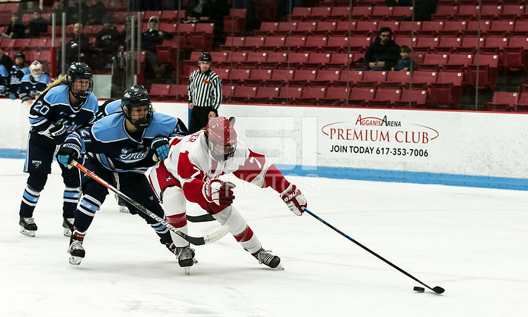BOSTON, MA - JANUARY 04: Jesse Compher #7 of Boston University on a break away as Tereza Vanisova #21 of University of Maine pressures during a game between University of Maine and Boston University at Walter Brown Arena on January 04, 2020 in Boston, Massachusetts.