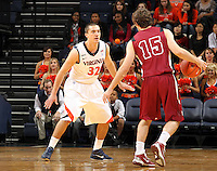 Nov 6, 2010; Charlottesville, VA, USA; Roanoke College f Zach Barrett (15) dribbles the ball in front of Virginia Cavaliers g Thomas Rogers (32) Saturday afternoon in exhibition action at John Paul Jones Arena. The Virginia men's basketball team recorded an 82-50 victory over Roanoke College.