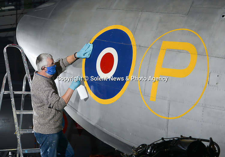 Pictured: Julian Puxley, volunteer at the Solent Sky museum, cleaning the outside of the Saunders-Roe SR.A-1.<br /> <br /> This Saunders-Roe SR.A-1 is the last remaining version of the plane, with only three prototypes ever being made. It is being stored on display at the Solent Sky museum. The plane never saw any military use, due to the fact that is was deemed inferior to land-based designs.<br /> <br /> The volunteers at Solent Sky have been hard at work getting the museum ready for attendees, as they prepare to open next month. Under the government guidelines in place after lockdown ends on 2nd December, and Southampton will enter tier 2 restirctions. This will allow museums like Solent Sky to reopen to the public.<br /> <br /> © Ewan Galvin/Solent News & Photo Agency<br /> UK +44 (0) 2380 458800