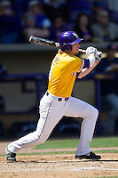 LSU Tigers outfielder Raph Rhymes #4 follows through on his swing against the Auburn Tigers in the NCAA baseball game on March 24, 2013 at Alex Box Stadium in Baton Rouge, Louisiana. LSU defeated Auburn 5-1. (Andrew Woolley/Four Seam Images).