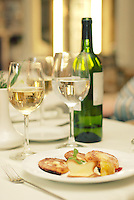 Green bottle of wine and two glasses in restaurant (Food Photography)