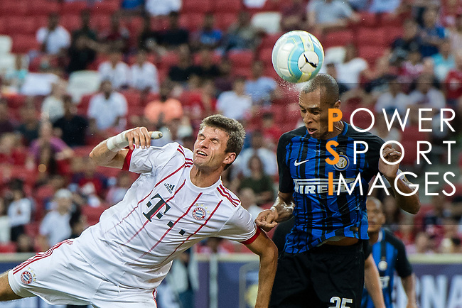 Bayern Munich Forward Thomas Muller (L) fights for the ball with FC Internazionale Defender Joao Miranda (R) during the International Champions Cup match between FC Bayern and FC Internazionale at National Stadium on July 27, 2017 in Singapore. Photo by Marcio Rodrigo Machado / Power Sport Images