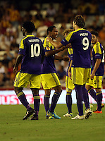 Valencia, Spain. Thursday 19 September 2013<br /> Pictured: Jonathan de Guzman of Swansea (C) celebrating his goal with co-scorers Wilfried Bony (L) and Michu (R), making the score 0-3 to his team<br /> Re: UEFA Europa League game against Valencia C.F v Swansea City FC, at the Estadio Mestalla, Spain,