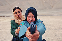 Police Officers, Bamiyan, Afghanistan, 2007<br /> Women police officers are shown here in training practice at a shooting range in Bamiyan. Today, women compromise 70% of Bamiyan's police force, an unusual statistic for this country. Since the start of the Taliban's rule women working outside the home has become rare in Afghanistan. According to World Bank figures, female labor force participation rate is at 19%, startlingly low compared to Western countries where 50-60% is typical. These Bamiyan policewomen play a pivotal role in reducing violence against women, giving security and confidence to female victims of human rights