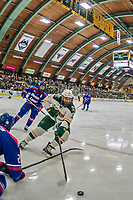 19 January 2018: University of Vermont Catamount Forward Conor O'Neil, a Junior from Hummelstown, PA, digs for the puck in the corner during the second period against the University of Massachusetts Lowell Riverhawks at Gutterson Fieldhouse in Burlington, Vermont. The Riverhawks rallied to defeat the Catamounts 3-2 in overtime of their Hockey East matchup. Mandatory Credit: Ed Wolfstein Photo *** RAW (NEF) Image File Available ***
