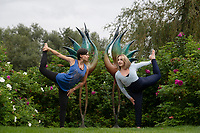 BNPS.co.uk (01202) 558833<br /> Pic: ZacharyCulpin/BNPS<br /> <br /> Life imitating art - Yoga teachers, Rachel Parker (left) and Lillie Hussain adopt similar poses to the sculptures near Dorchester before the start of the five-day festival, 'Wellbeing by the lakes'.<br /> <br /> The event aims to explore 'what it means to be mindful and live well in a fast-paced modern world' It is held is in the 26 acre Sculpture by the Lakes park in the heart of Dorset countryside.  <br /> <br /> There will be expert talks, guided meditations, yoga art and shopping, 'movement sessions', sound baths and healing therapies. It takes place from September 8 to September 12