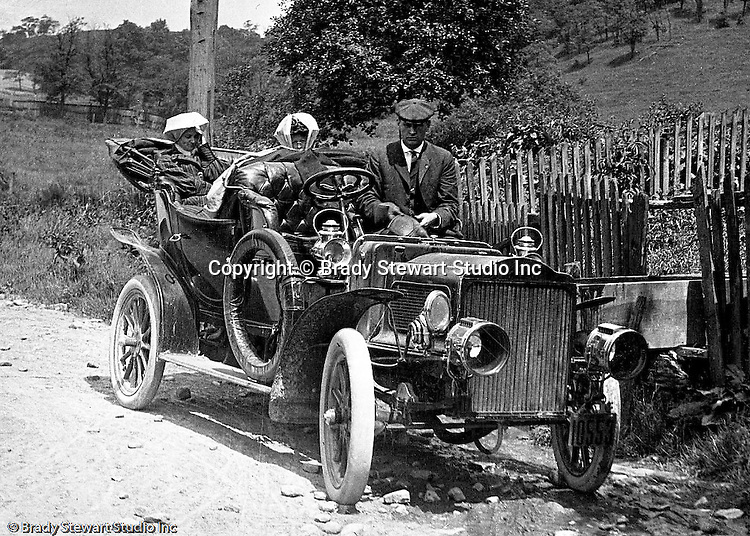 """Product: Buick Model F<br /> Manufacturer: Buick Auto-Vim and Power Company,<br /> <br /> Westmoreland County PA:  Brady Stewart and friends out for a drive on the Pittsburgh to Greensburg Turnpike. The women and men are all wearing """"motoring clothes"""" for the trip."""