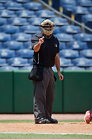 Home plate umpire Lorenz Evans calls a strike during a game between the Lakeland Flying Tigers and the Clearwater Threshers on May 2, 2018 at Spectrum Field in Clearwater, Florida.  Clearwater defeated Lakeland 7-5.  (Mike Janes/Four Seam Images)