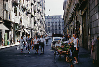 People walking by the fruit cart, Rome, Italy. 1959.