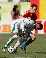 Spanish midfielder (13) Iniesta tries to take control of the ball away from Saudi Arabian midfielder (8) Mohammed Noor. Spain defeated Saudi Arabia, 1-0, in their FIFA World Cup Group H match at Fritz-Walter-Stadion in Kaiserslautern, Germany, June 23, 2006.