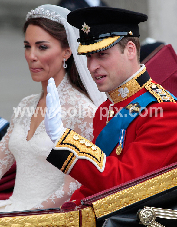 **ALL ROUND PICTURES FROM SOLARPIX.COM**                                             **NO UK NEWSPAPER PUBLICATION**.**UK MAGAZINE & SUPPLEMENT PUBLICATION ONLY** AND NO PUBLICATION IN AUSTRALIA, BELGIUM, FRANCE, GERMANY, ITALY, SCANDINAVIA AND USA**                                                                                  Caption: Prince William and Kate Middleton leave Westminster Abbey after their wedding ceremony. London, UK. 29 April 2011                                                                              This pic: Prince William and Kate Middleton                                          JOB REF: 13229 SFE       DATE: 29_04_2011                                                           **MUST CREDIT SOLARPIX.COM OR DOUBLE FEE WILL BE CHARGED**                                                                      **MUST AGREE FEE BEFORE ONLINE USAGE**                               **CALL US ON: +34 952 811 768 or LOW RATE FROM UK 0844 617 7637**