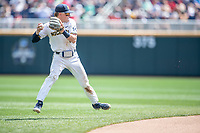 Michigan Wolverines shortstop Jack Blomgren (2) makes a tough throw to first base during Game 11 of the NCAA College World Series against the Texas Tech Red Raiders on June 21, 2019 at TD Ameritrade Park in Omaha, Nebraska. Michigan defeated Texas Tech 15-3 and is headed to the CWS Finals. (Andrew Woolley/Four Seam Images)
