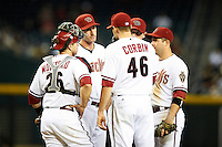 Arizona Diamondbacks pitching coach Charles Nagy #50 (second from left) talks with pitcher Patrick Corbin #46, catcher Miguel Montero #26, infielders Chris Johnson #28 (hidden), John McDonald #16 (far right) during a National League regular season game against the Colorado Rockies at Chase Field on October 3, 2012 in Phoenix, Arizona. Arizona defeated Colorado 5-3. (Mike Janes/Four Seam Images)