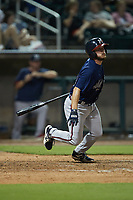 Riley Delgado (51) of the Mississippi Braves follows through on his swing against the Birmingham Barons at Regions Field on August 3, 2021, in Birmingham, Alabama. (Brian Westerholt/Four Seam Images)