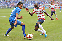 DaMarcus Beasley (7) of the USMNT goes against Darwin Ceren Delgado (7) of El Salvador.  The USMNT defeated El Salvador 5-1 at the quaterfinal game of the Concacaf Gold Cup, M&T Stadium, Sunday July 21 , 2013.