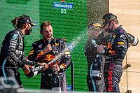 5th September 2021: Circuit Zandvoort, Zandvoort, Netherlands;  Formula 1 Dutch Grand Prix at the CM.com Circuit Zandvoort , Max verstappen wins the dutch Grand Prix and sprays champaign with Lewis Hamilton l and Valtteri Bottas