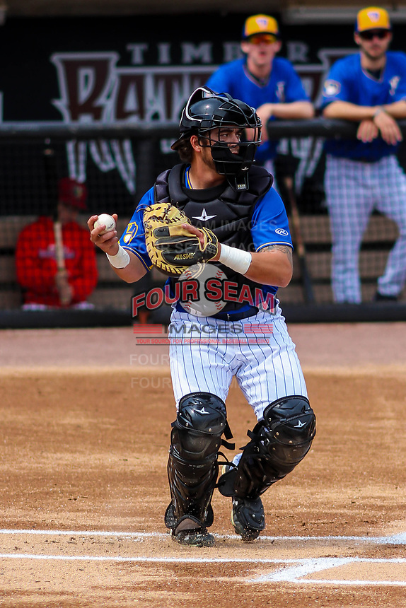 Wisconsin Timber Rattlers catcher Nathan Rodriguez (9) throws down to second base prior to the start of a Midwest League game against the Quad Cities River Bandits on April 9, 2017 at Fox Cities Stadium in Appleton, Wisconsin.  Quad Cities defeated Wisconsin 17-11. (Brad Krause/Four Seam Images)