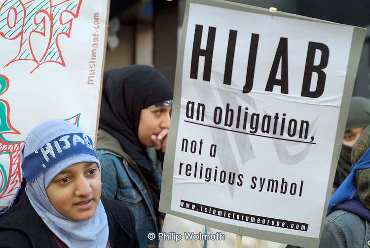 A young woman protests outside the French Embassy in Knightsbridge, London, against the proposed ban on religious and political symbols in French state  schools, which would outlaw the wearing of the Muslim hijab.