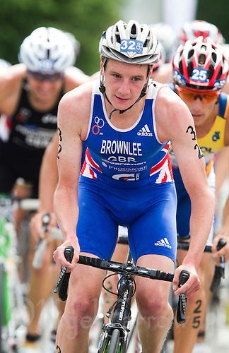24 JUN 2012 - KITZBUEHEL, AUT - Alistair Brownlee (GBR) of Great Britain (centre) leads the front pack during the bike at the elite men's 2012 World Triathlon Series round in Schwarzsee, Kitzbuehel, Austria (PHOTO (C) 2012 NIGEL FARROW)