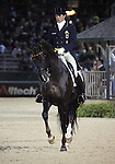 Christoph Koschel and Donnperignon of Germany perform their Freestyle Dressage in the Grand Prix Freestyle Dressage competition at the Alltech World Equestrian Games in Lexington, Kentucky.