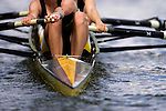 A crew rows down the river as they compete during the 68th Dad Vail Regatta on the Schuylkill River in Philadelphia, Pennsylvania on May 12, 2006..