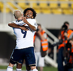 Ikechi Anya celebrates his goal for Scotland with Steven Naismith