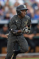Vanderbilt Commodores designated hitter Ro Coleman (1) runs to first base during the NCAA College baseball World Series against the Cal State Fullerton Titans on June 14, 2015 at TD Ameritrade Park in Omaha, Nebraska. The Titans were leading 3-0 in the bottom of the sixth inning when the game was suspended by rain. (Andrew Woolley/Four Seam Images)