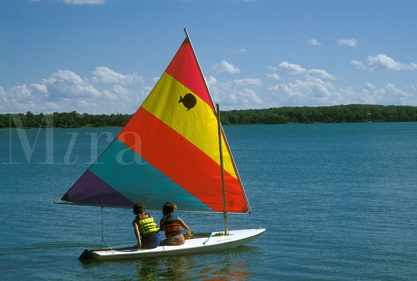sailing, MN, Minnesota, Alexandria, A couple sails a sunfish on Maple Lake in Alexandria in the summer.