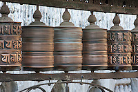 Kathmandu, Nepal.  Spinning Prayer Wheels at Swayambhunath Temple.