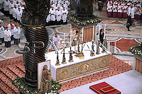 Pope Benedict XVI meets children during the midndight Christmas Mass in Saint Peter's Basilica at the Vatican late 24 December 2008.