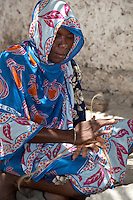 Jambiani, Zanzibar, Tanzania.  Woman Making Rope from Coir, Coconut Husk Fiber.