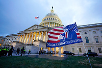 Trump supporters left a flag outside the Capitol, Wednesday evening, Jan. 6, 2021, in Washington. As Congress prepares to affirm President-elect Joe Biden's victory, thousands of people have gathered to show their support for President Donald Trump and his claims of election fraud. (AP Photo/Manuel Balce Ceneta)