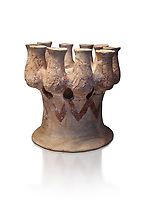 Cycladic Kernos a multiple vessel in a base.  Early Cycladic III (2300-2000 BC) , Phylakopi, Melos. National Archaeological Museum Athens. Cat No 5829.  White background.<br /> <br /> <br /> This complex vessel was used for ritual offerings. During this period pottery was plainer with simple geometric decorations. Depicts of birds or lowers were rare.